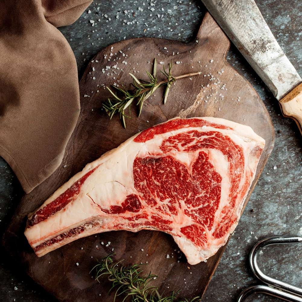 Fresh steak piece with knife table min