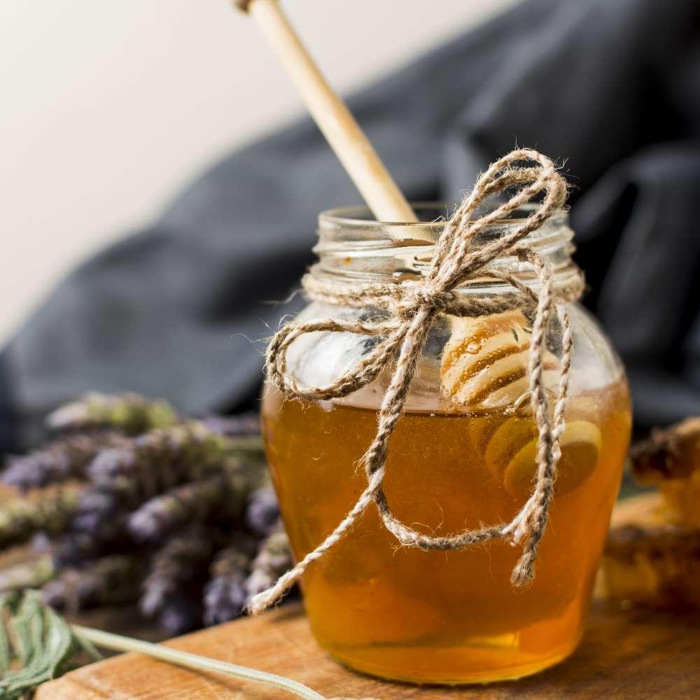 Honey jar with spoon lavender