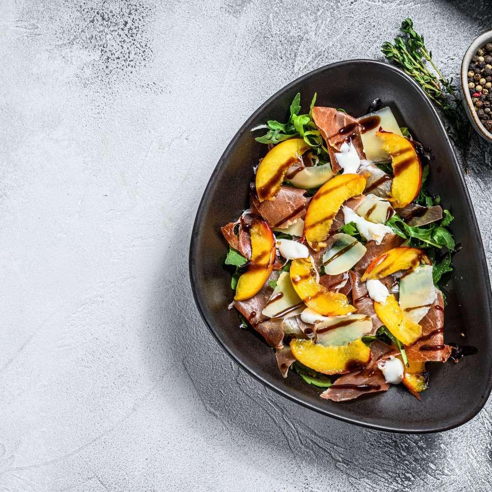 Salad with prosciutto peach arugula min